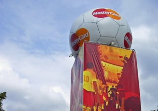 Inflatable advertising tower with inflatable football