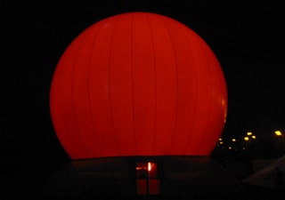 Lighted inflatable globe with light effects